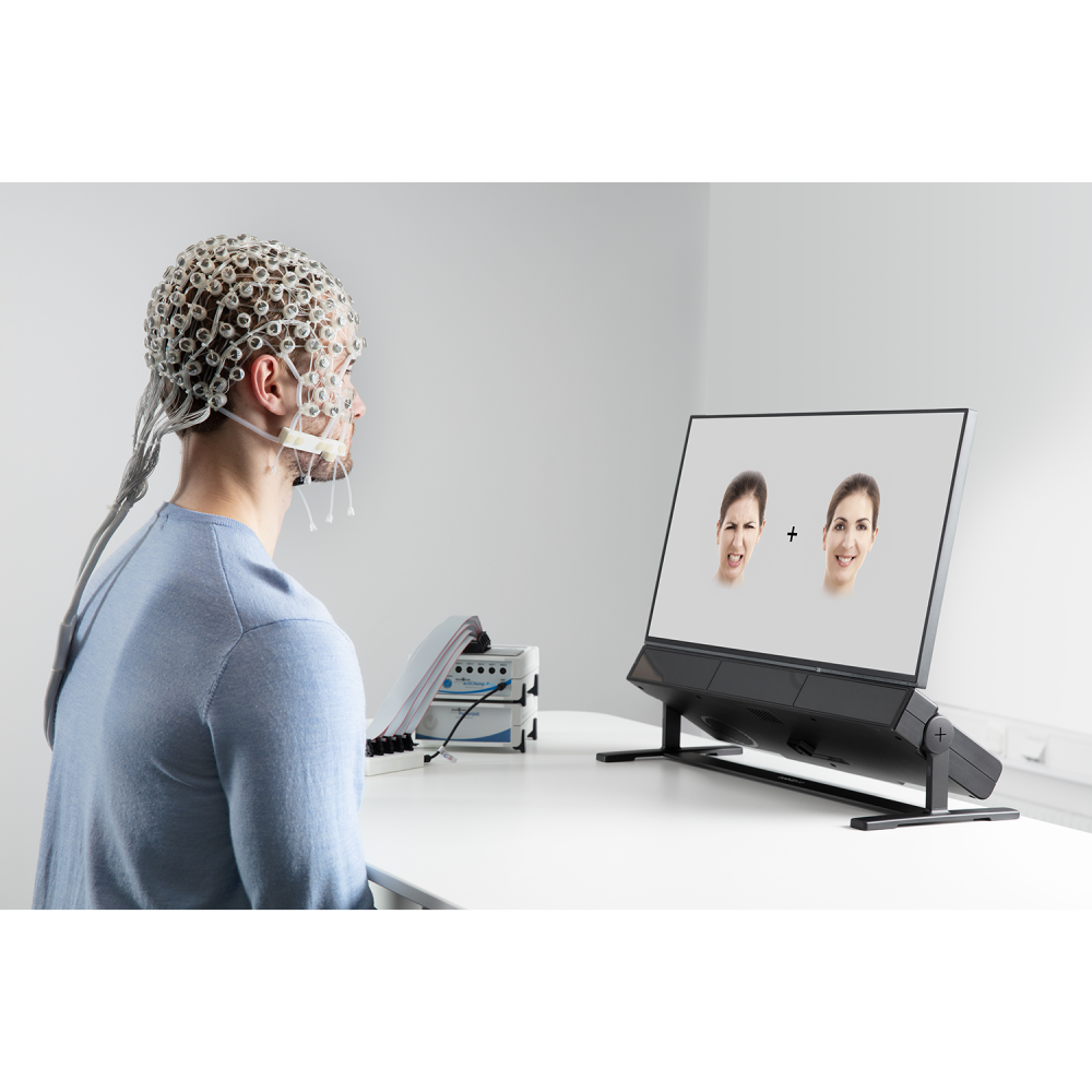 A person using Tobii Pro Spectrum and Brain Products to study emotions