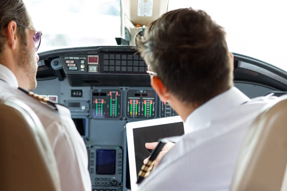 2 pilot doing a safety check in the cockpit