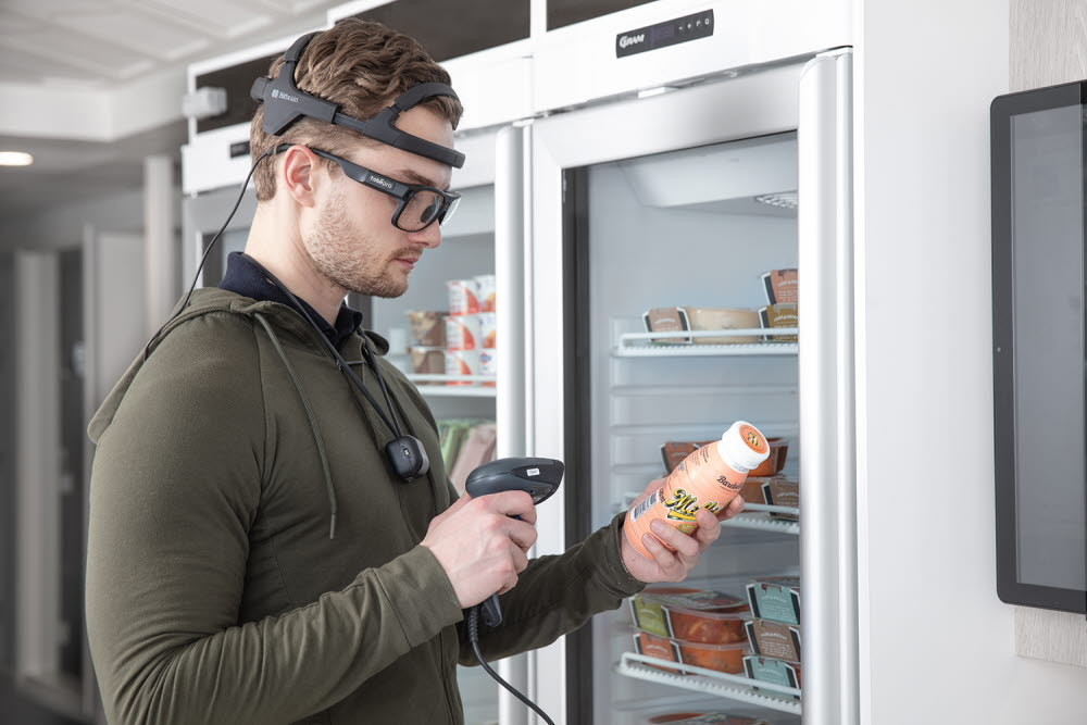 A person using Tobii Pro Glasses 3 and Bitbrain Diadem to look at grocery items