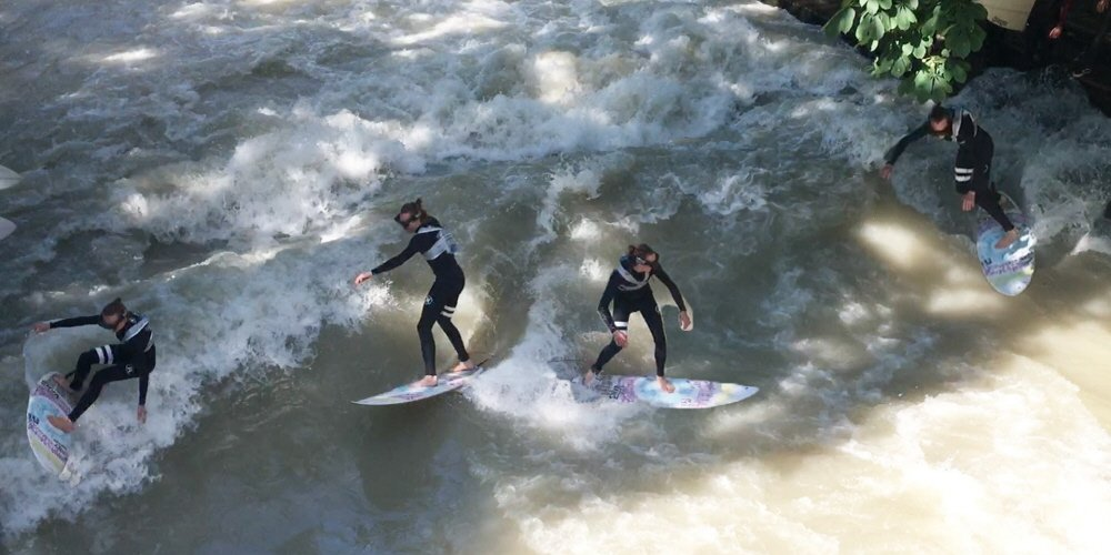 Four people perform surf runs while wearing Tobii Pro Glasses 2.