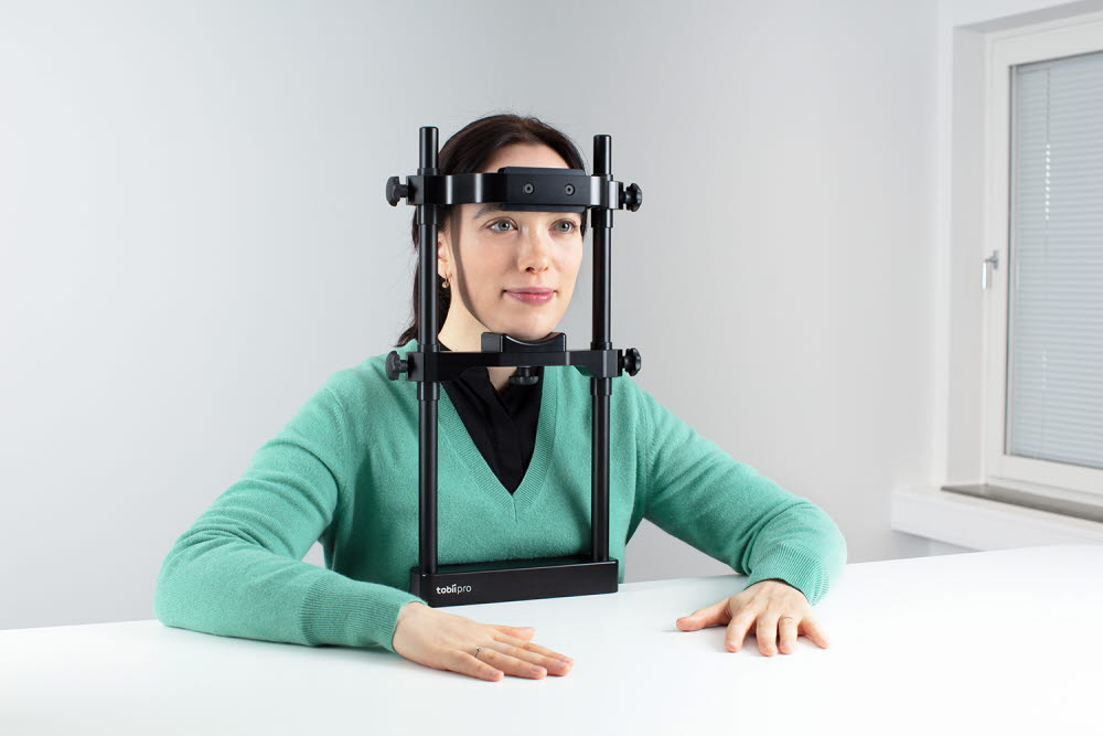 Woman using a Tobii Pro Chin Rest